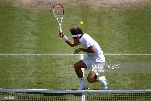 Roger Federer of Switzerland avoids getting hit with the tennis ball during his Gentlemen's Singles final match against Andy Murray of Great Britain...