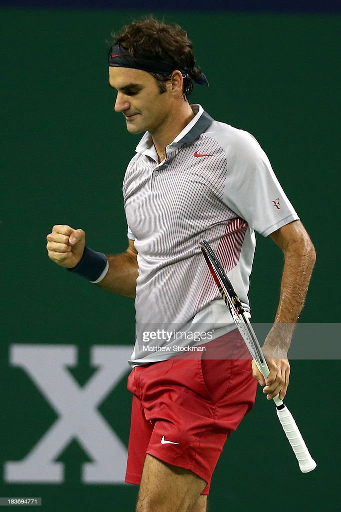 Roger Federer of Switzerland celebrates a point against Andreas Seppi of Italy during the Shanghai Rolex Masters at the Qi Zhong Tennis Center on October 9, 2013 in Shanghai, China.
