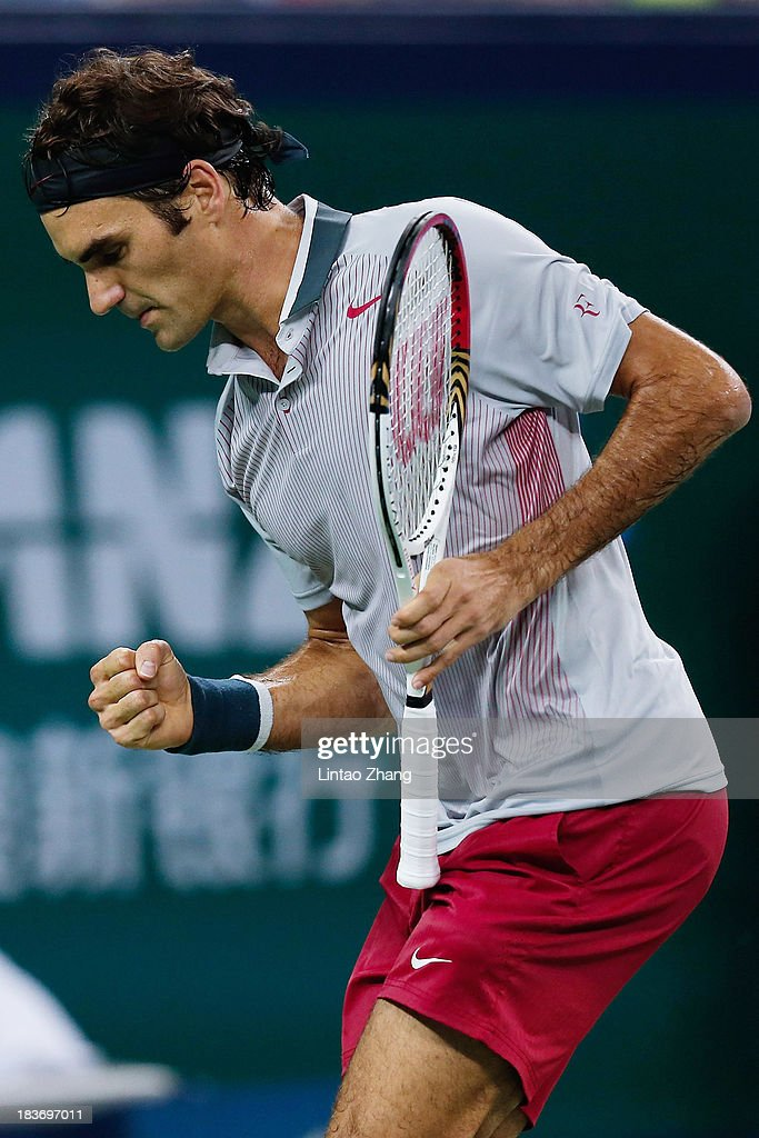 Roger Federer of Switzerland celebrates a point against Andreas Seppi of Italy during day three of the Shanghai Rolex Masters at the Qi Zhong Tennis Center on October 9, 2013 in Shanghai, China.