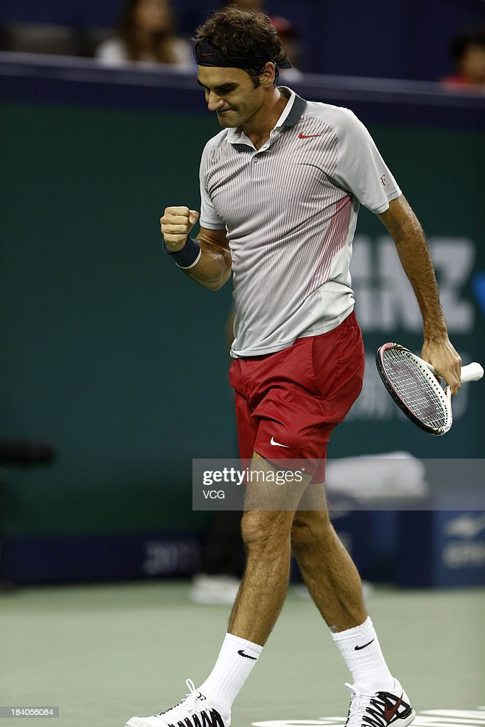 Roger Federer of Switzerland celebrates a point against Andreas Seppi of Italy on day three of the Shanghai Rolex Masters at the Qi Zhong Tennis Center on October 9, 2013 in Shanghai, China.