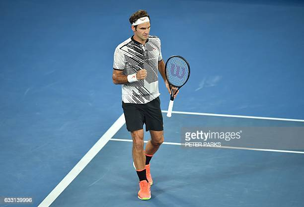 Roger Federer of Switzerland celebrates after breaking the serve of Rafael Nadal of Spain during the men's singles final on day 14 of the Australian...