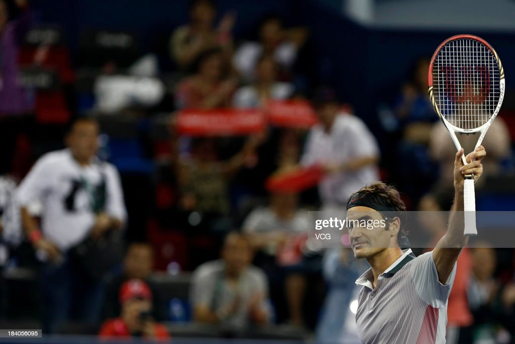 Roger Federer of Switzerland celebrates after defeating Andreas Seppi of Italy on day three of the Shanghai Rolex Masters at the Qi Zhong Tennis Center on October 9, 2013 in Shanghai, China.