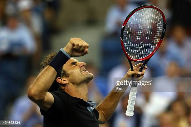 Roger Federer of Switzerland celebrates after defeating Gael Monfils of France during their men's singles quarterfinal match on Day Eleven of the...