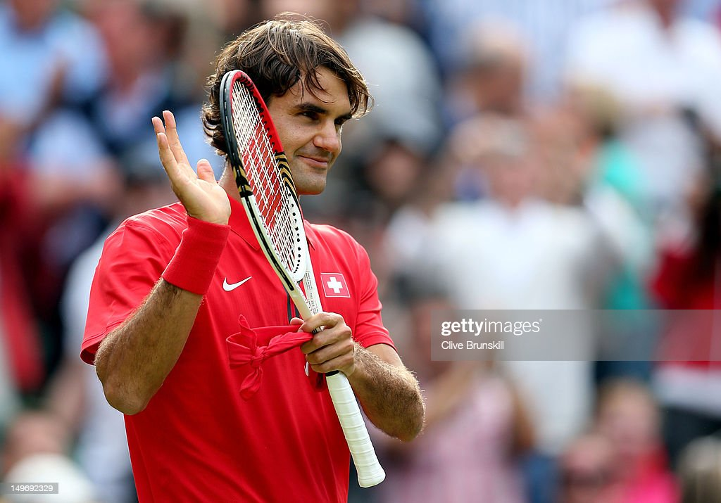 <a gi-track='captionPersonalityLinkClicked' href=/galleries/search?phrase=Roger+Federer&family=editorial&specificpeople=157480 ng-click='$event.stopPropagation()'>Roger Federer</a> of Switzerland celebrates after defeating John Isner of the United States during the Quarterfinal of Men's Singles Tennis on Day 6 of the London 2012 Olympic Games at Wimbledon on August 2, 2012 in London, England.