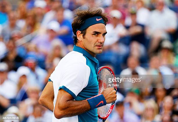 Roger Federer of Switzerland celebrates after defeating Philipp Kohlschreiber of Germany during their Men's Singles Third Round match on Day Six of...