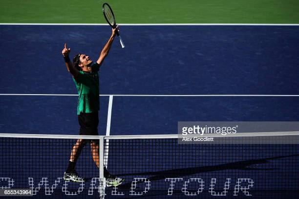 Roger Federer of Switzerland celebrates after defeating Stan Wawrinka of Switzerland in the men's final on day 14 during the BNP Paribas Open at...