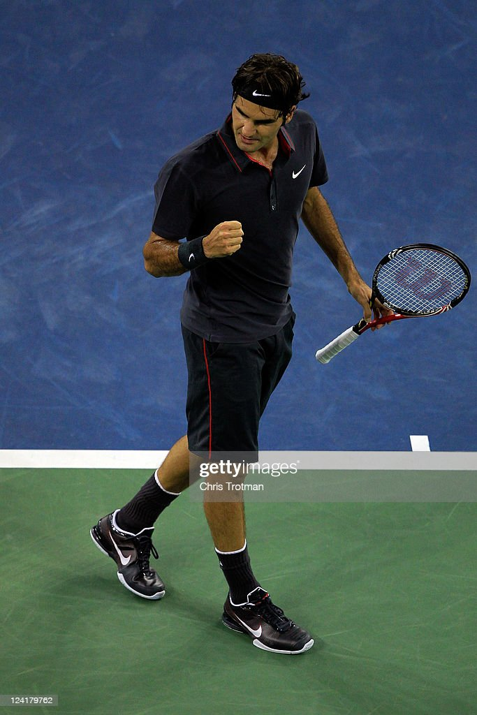 <a gi-track='captionPersonalityLinkClicked' href=/galleries/search?phrase=Roger+Federer&family=editorial&specificpeople=157480 ng-click='$event.stopPropagation()'>Roger Federer</a> of Switzerland celebrates after he wom match point against Jo-Wilfried Tsonga of France during Day Eleven of the 2011 US Open at the USTA Billie Jean King National Tennis Center on September 8, 2011 in the Flushing neighborhood of the Queens borough of New York City.