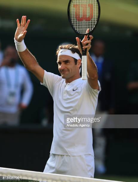 Roger Federer of Switzerland celebrates after his victory over Milos Raonic of Canada on day nine of the 2017 Wimbledon Championships at the All...