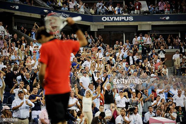 Roger Federer of Switzerland celebrates after returning a shot through his legs to Novak Djokovic of Serbia during their semifinal match at the 2009...