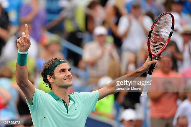Roger Federer of Switzerland celebrates after winning a final match against David Ferrer of Spain on day 9 of the Western Southern Open at the Linder...