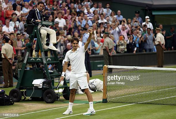 Roger Federer of Switzerland celebrates after winning his Gentlemen's Singles final match against Andy Murray of Great Britain on day thirteen of the...