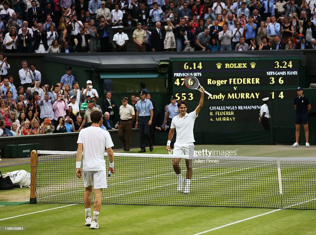 <a gi-track='captionPersonalityLinkClicked' href=/galleries/search?phrase=Roger+Federer&family=editorial&specificpeople=157480 ng-click='$event.stopPropagation()'>Roger Federer</a> of Switzerland celebrates after winning his Gentlemen's Singles final match against <a gi-track='captionPersonalityLinkClicked' href=/galleries/search?phrase=Andy+Murray+-+Tennisser&family=editorial&specificpeople=200668 ng-click='$event.stopPropagation()'>Andy Murray</a> of Great Britain on day thirteen of the Wimbledon Lawn Tennis Championships at the All England Lawn Tennis and Croquet Club on July 8, 2012 in London, England.