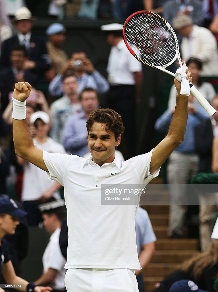 Roger Federer of Switzerland celebrates after winning his Gentlemen's Singles final match against Andy Murray of Great Britain on day thirteen of the Wimbledon Lawn Tennis Championships at the All England Lawn Tennis and Croquet Club on July 8, 2012 in London, England.