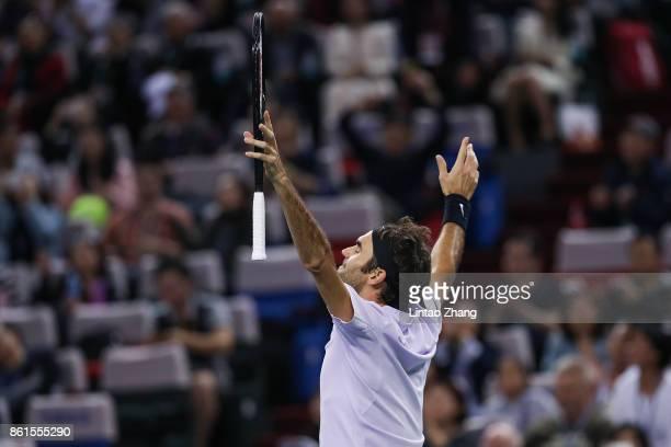 Roger Federer of Switzerland celebrates after winning the Men's singles final against Rafael Nadal of Spain on day eight of 2017 ATP Shanghai Rolex...