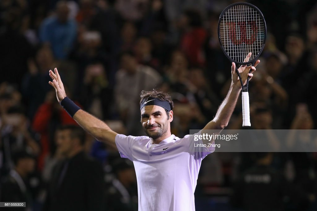 Roger Federer of Switzerland celebrates after winning the Men's singles final against Rafael Nadal of Spain on day eight of 2017 ATP Shanghai Rolex Masters at Qizhong Stadium on October 15, 2017 in Shanghai, China.