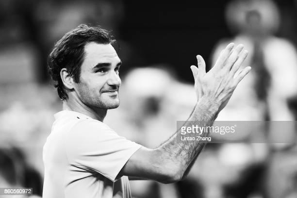 Roger Federer of Switzerland celebrates after winning the Men's singles mach third round against Alexandr Dolgopolov of Ukraine on day five of 2017...