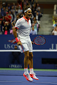 Roger Federer of Switzerland celebrates after winning the second set against Novak Djokovic of Serbia during their Men's Singles Final match on Day...