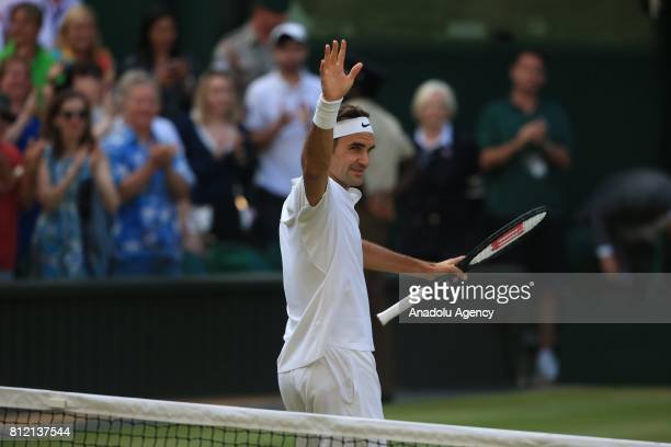 Roger Federer of Switzerland celebrates beating Grigor Dimitrov of Bulgaria on day seven of the 2017 Wimbledon Championships at the All England Lawn...