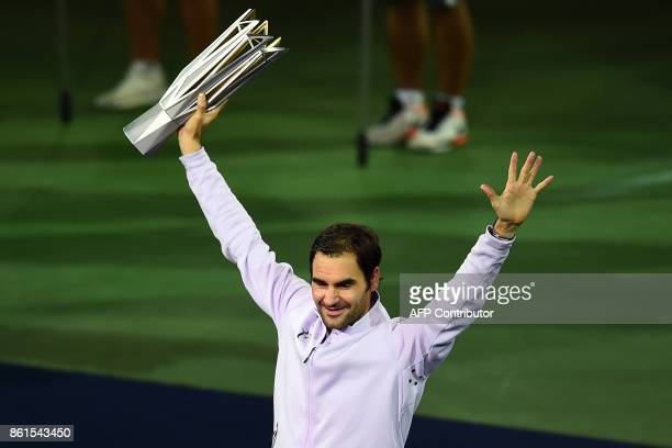 Roger Federer of Switzerland celebrates beating Rafael Nadal of Spain to win the men's singles final match at the Shanghai Masters tennis tournament...
