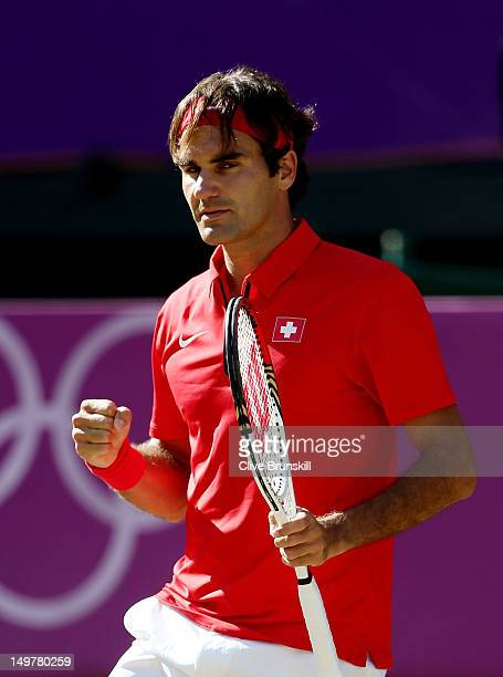 Roger Federer of Switzerland celebrates breaking the 17th game against Juan Martin Del Potro of Argentina in the Semifinal of Men's Singles Tennis on...
