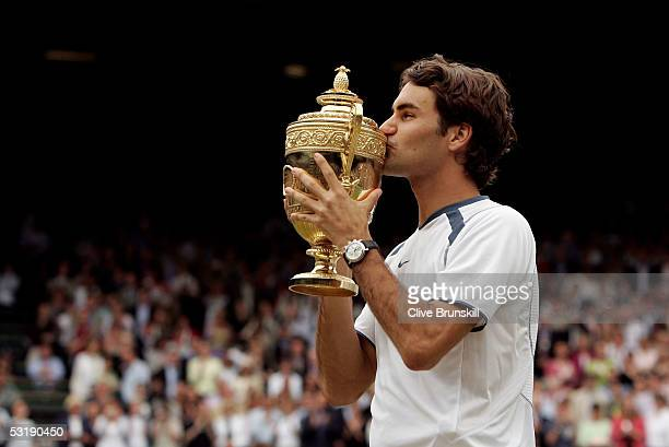 Roger Federer of Switzerland celebrates by kissing the trophy after winning in straight sets against Andy Roddick of the USA in the Mens Singles...