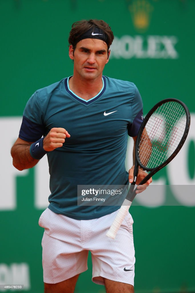 <a gi-track='captionPersonalityLinkClicked' href=/galleries/search?phrase=Roger+Federer&family=editorial&specificpeople=157480 ng-click='$event.stopPropagation()'>Roger Federer</a> of Switzerland celebrates defeating Jo-Wilfried Tsonga of France during day six of the ATP Monte Carlo Rolex Masters Tennis at Monte-Carlo Sporting Club on April 18, 2014 in Monte-Carlo, Monaco.