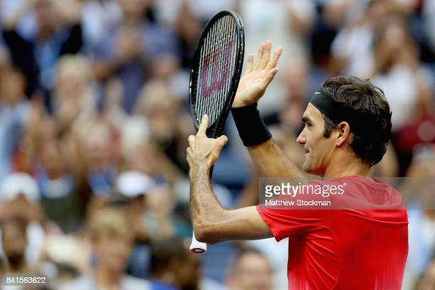 Roger Federer of Switzerland celebrates defeating Mikhail Youzhny of Russia during their second round Men's Singles match on Day Four of the 2017 US...
