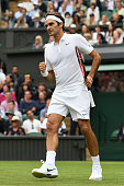 Roger Federer of Switzerland celebrates during the Men's Singles first round against Giodo Pella of Argentina on day one of the Wimbledon Lawn Tennis...