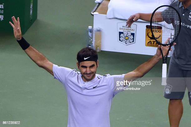 Roger Federer of Switzerland celebrates his victory against Juan Martin del Potro of Argentina during their men's singles semifinal match at the...