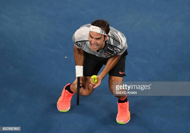 Roger Federer of Switzerland celebrates his victory over Rafael Nadal of Spain in the men's singles final on day 14 of the Australian Open tennis...