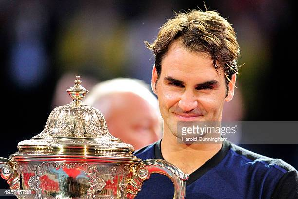 Roger Federer of Switzerland celebrates his victory with the trophy after the Swiss Indoors ATP 500 Final against Rafael Nadal of Spain at St...