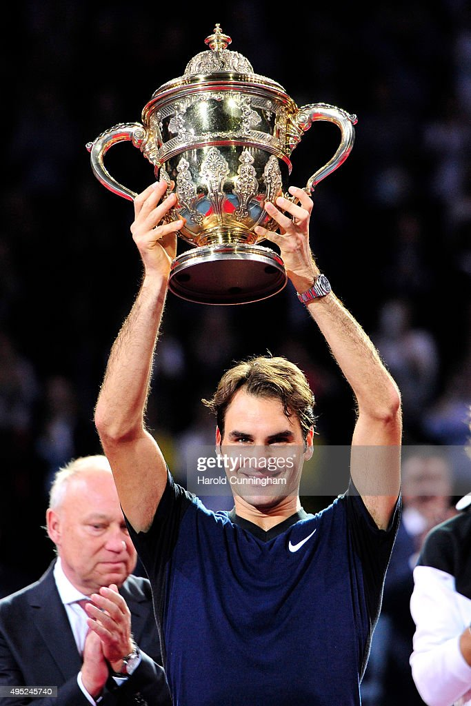 Roger Federer of Switzerland celebrates his victory with the trophy after the Swiss Indoors ATP 500 Final against Rafael Nadal of Spain at St Jakobshalle on November 1, 2015 in Basel, Switzerland