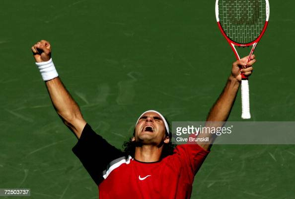 Roger Federer of Switzerland celebrates match point after defeating Rafael Nadal of Spain in the men's final during the NASDAQ100 Open at the Crandon...