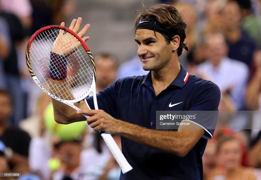<a gi-track='captionPersonalityLinkClicked' href=/galleries/search?phrase=Roger+Federer&family=editorial&specificpeople=157480 ng-click='$event.stopPropagation()'>Roger Federer</a> of Switzerland celebrates match point after his men's singles second round match against Bjorn Phau of Germany on Day Four of the 2012 US Open at USTA Billie Jean King National Tennis Center on August 30, 2012 in the Flushing neigborhood of the Queens borough of New York City.