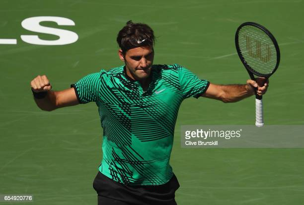 Roger Federer of Switzerland celebrates match point against Jack Sock of the United States in their semi final match during day thirteen of the BNP...