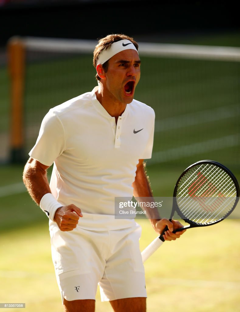 Roger Federer of Switzerland celebrates match point and victory after the Gentlemen's Singles quarter final match against Milos Raonic of Canada on day nine of the Wimbledon Lawn Tennis Championships at the All England Lawn Tennis and Croquet Club on July 12, 2017 in London, England.