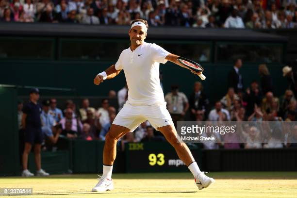 Roger Federer of Switzerland celebrates match point and victory after the Gentlemen's Singles quarter final match against Milos Raonic of Canada on...