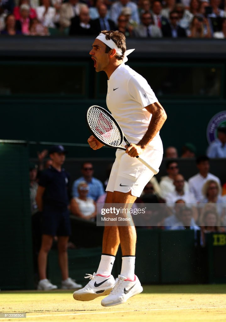 Roger Federer of Switzerland celebrates match point and victory during the Gentlemen's Singles quarter final match against Milos Raonic of Canada on day nine of the Wimbledon Lawn Tennis Championships at the All England Lawn Tennis and Croquet Club on July 12, 2017 in London, England.