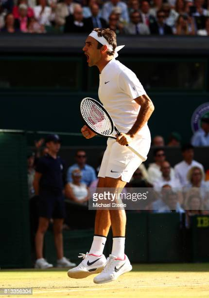 Roger Federer of Switzerland celebrates match point and victory during the Gentlemen's Singles quarter final match against Milos Raonic of Canada on...