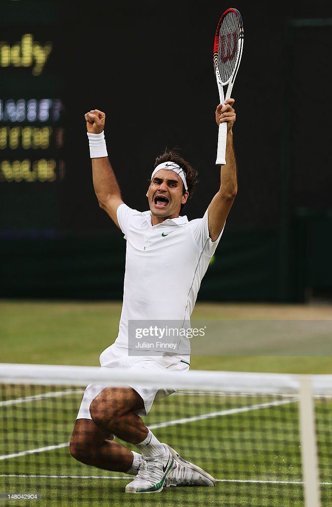 Roger Federer of Switzerland celebrates match point during his Gentlemen's Singles final match against Andy Murray of Great Britain on day thirteen of the Wimbledon Lawn Tennis Championships at the All England Lawn Tennis and Croquet Club on July 8, 2012 in London, England.