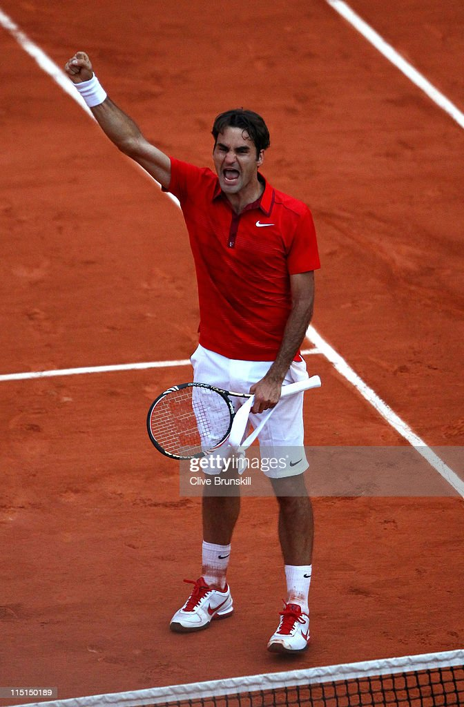 Roger Federer of Switzerland celebrates match point during the men's singles semi final match between Roger Federer of Switzerland and Novak Djokovic of Serbia on day thirteen of the French Open at Roland Garros on June 3, 2011 in Paris, France.