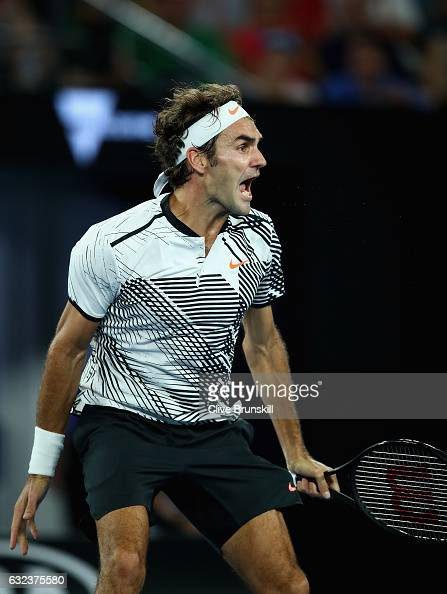 Roger Federer of Switzerland celebrates match point in his fourth round match against Kei Nishikori of Japan on day seven of the 2017 Australian Open...