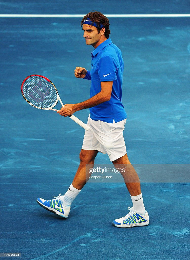 Roger Federer of Switzerland celebrates matchpoint over Janko Tipsarevic of Serbia in his semi final match during the Mutua Madrilena Madrid Open tennis tournament at the Caja Magica on May 12, 2012 in Madrid, Spain.