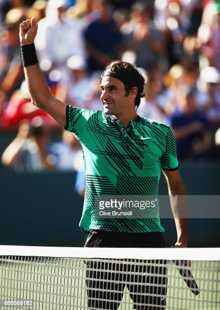 Roger Federer of Switzerland celebrates to the crowd after his straight sets victory against Stanislas Wawrinka of Switzerland in the mens final...