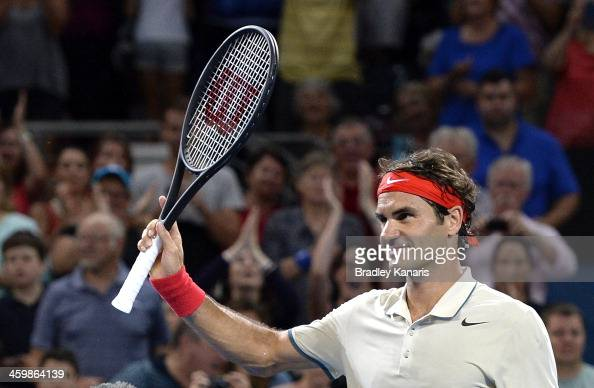 Roger Federer of Switzerland celebrates victory as he waves to fans after his match against Jarkko Nieminen of Finland during day four of the 2014...