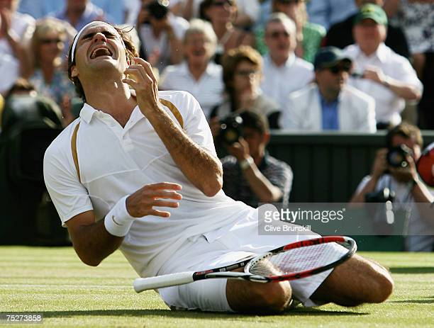 Roger Federer of Switzerland celebrates victory following the Men's Singles final match against Rafael Nadal of Spain during day thirteen of the...