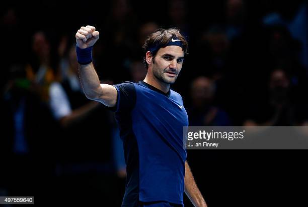 Roger Federer of Switzerland celebrates victory in his men's singles match against Novak Djokovic of Serbia during day three of the Barclays ATP...