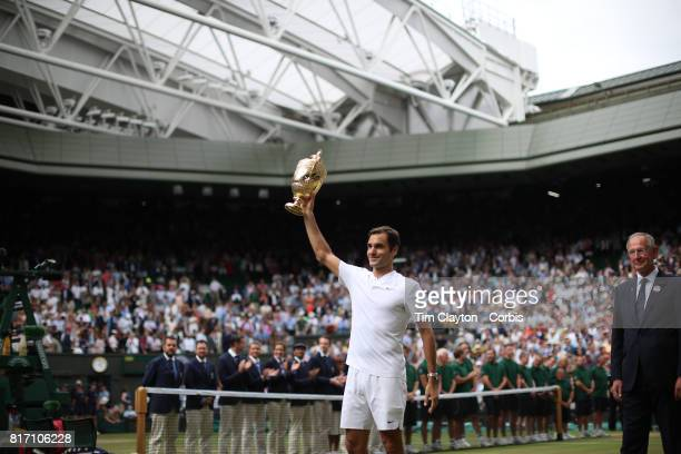 Roger Federer of Switzerland celebrates victory with the trophy after his win against against Marin Cilic of Croatia in the Gentlemen's Singles final...