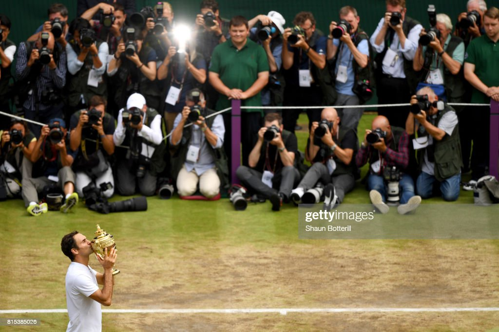 Roger Federer of Switzerland celebrates victory with the trophy as he poses for photographers after the Gentlemen's Singles final against Marin Cilic of Croatia on day thirteen of the Wimbledon Lawn Tennis Championships at the All England Lawn Tennis and Croquet Club at Wimbledon on July 16, 2017 in London, England.