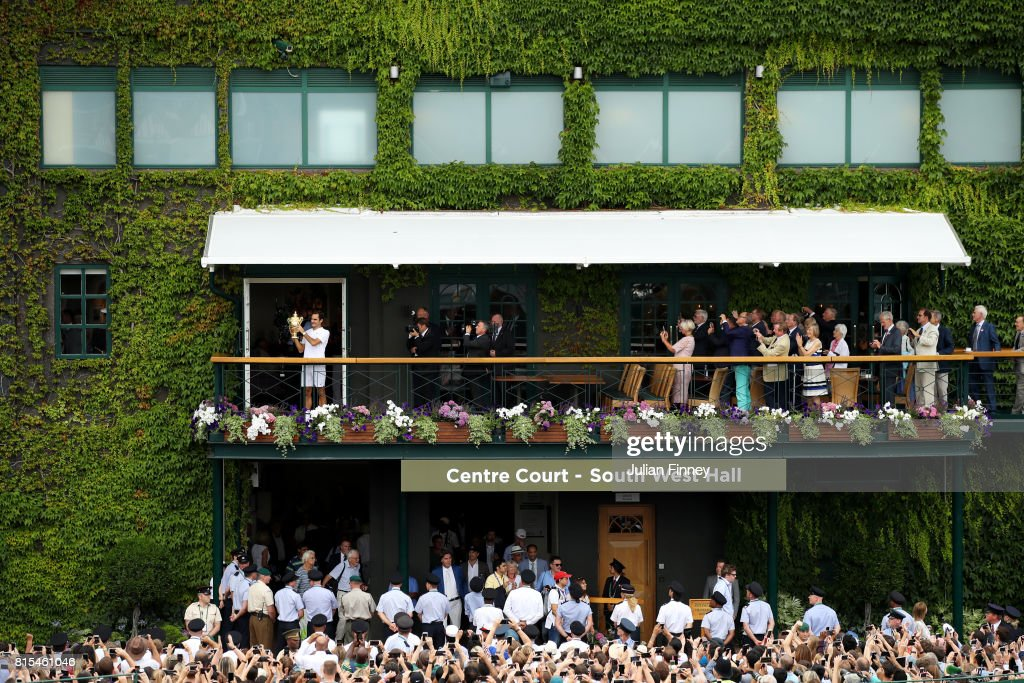 Roger Federer of Switzerland celebrates victory with the trophy on the balcony after the Gentlemen's Singles final against Marin Cilic of Croatia on day thirteen of the Wimbledon Lawn Tennis Championships at the All England Lawn Tennis and Croquet Club at Wimbledon on July 16, 2017 in London, England.